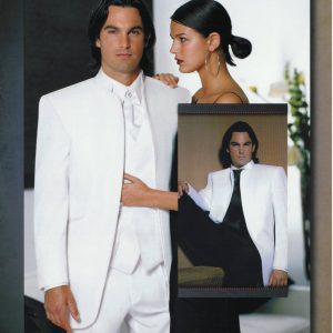 Man wearing white tuxedo with white vest and black vest